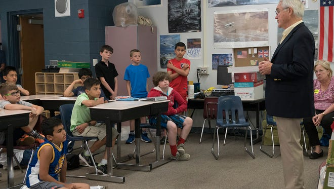 Vietnam Veteran Mike O'Dea speaks to David Wayne's fifth grade class at Silver Springs Elementary in Northville Twp.