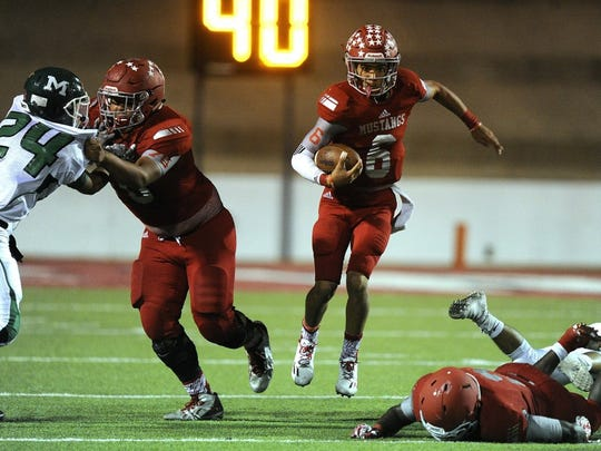 Thomas Metthe/Reporter-News Sweetwater quarterback Chris Thompson (6) hurdles a lineman during the fourth quarter of Sweetwater's 19-16 loss on Friday at the Mustang Bowl in Sweetwater.