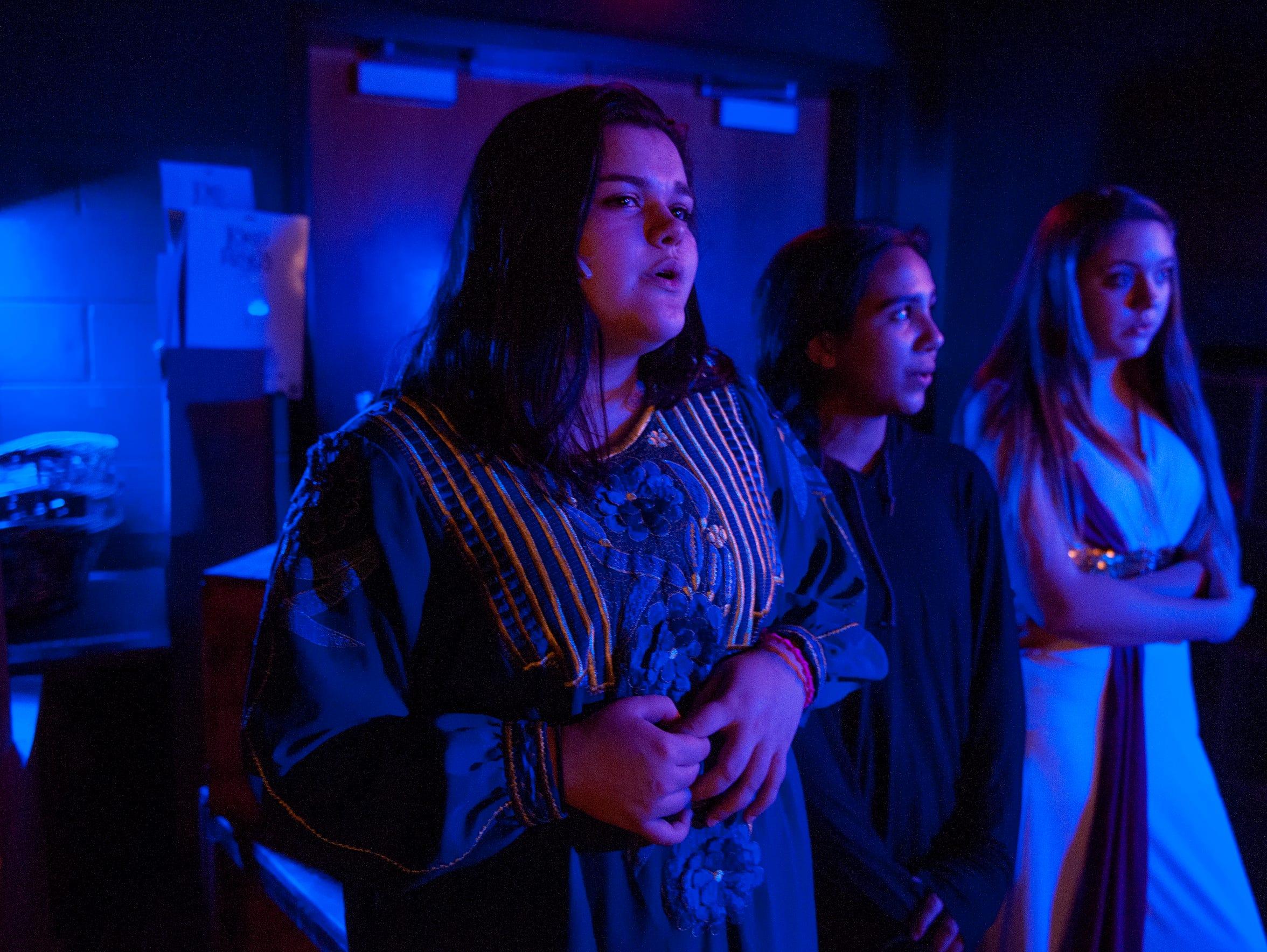 Lenape High School student Aniela Mazzola (left) sings