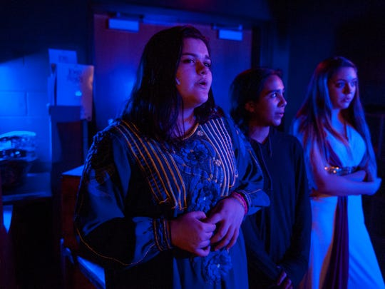 """Lenape High School student Aniela Mazzola (left) sings backstage during a dress rehearsal of Lenape High School's production of """"Aida""""  in the school's auditorium. It's the school's spring musical and will open on March 2 at 7 p.m. at the school."""