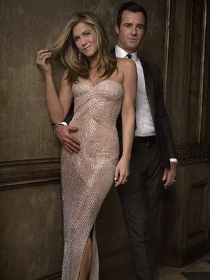 Jennifer Aniston and Justin Theroux pose at the Oscars after-party.