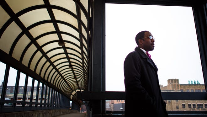 Waterloo's Mayor elect Quentin Hart stands on the covered walkway bridge over the Cedar Rive on Monday, December 21, 2015 in Downtown Waterloo. Hart said he heard the news that he had defeated former Mayor Tim Hurley on the bridge during the cities runoff election on December 1.