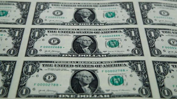 A sheet of new $1 bills with the signatures of U.S.