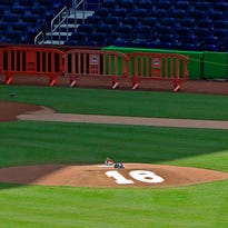 The Miami Marlins place the number 16 on the back of the pitcher's mound in a memorial for starting pitcher Jose Fernandez who was killed in a boating accident on Sunday.