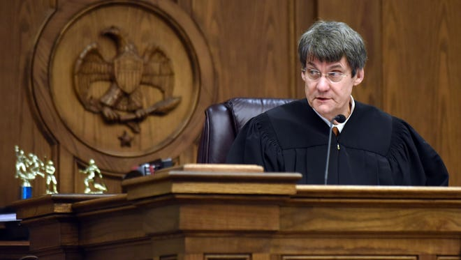 Newly elected Judge Jon Mark Weathers listens to cases in the 12th District Circuit Courtroom on Friday.