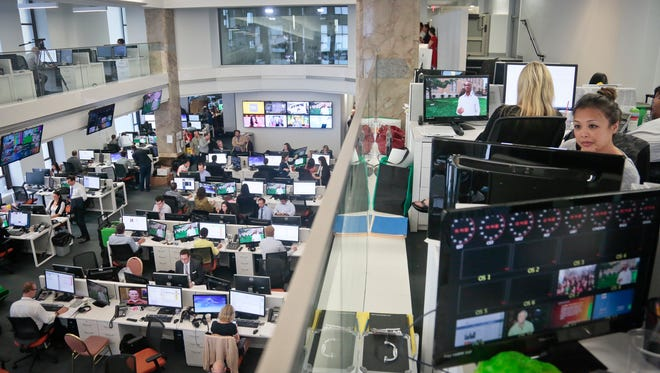 Staffers work in the Al-Jazeera America newsroom after the network's first broadcast on Tuesday, Aug. 20, 2013 in New York. The Qatar-based Al-Jazeera Media Network launched its U.S. outlet only eight months after announcing the new venture, which on Tuesday replaced Al Gore's Current TV in more than 45 million TV homes.