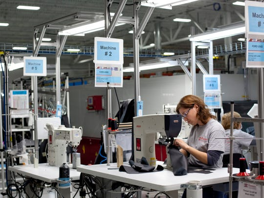 Employees work sections of leather trim components on sewing machines Wednesday, November 11, 2015 at Eissmann Group Automotive, 2440 20th Street in Port Huron. Eissmann will be undergoing a two-phase expansion project, bringing the facility from 60,000-square-feet to 148,000-square-feet by 2018. The project is expected to increase employment from 108 to 160 jobs in 2016, with the possibility of more than 300 by 2018.