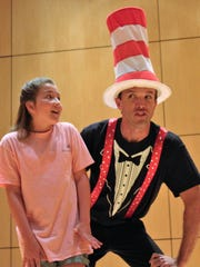 "Carrie Mercer, left, is the boy Jojo while Keith May is his new best friend, the Cat in the Hat, in ""Seussical,"" a Clyde Center for the Performing Arts production."