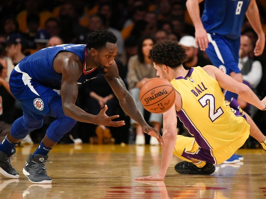 LA Clippers guard Patrick Beverley (21) steals the
