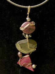 Barnes created this wire wrapped pendant for a choker using three semi-precious stones and pearls.