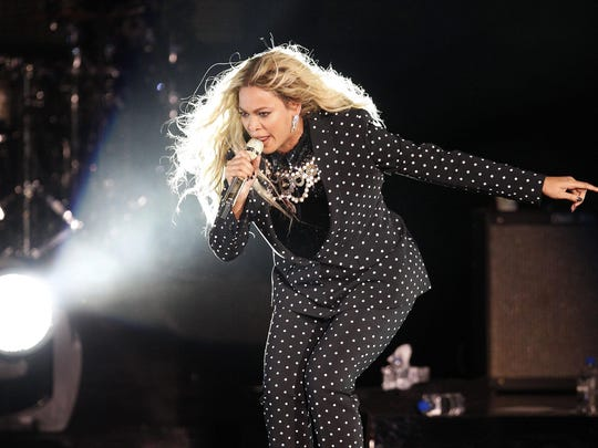 Beyoncé performs on stage at a campaign event for Democratic presidential candidate Hillary Clinton on Nov. 4 in Cleveland. She leads with nine Grammy Award nominations and vying once again for album of the year.