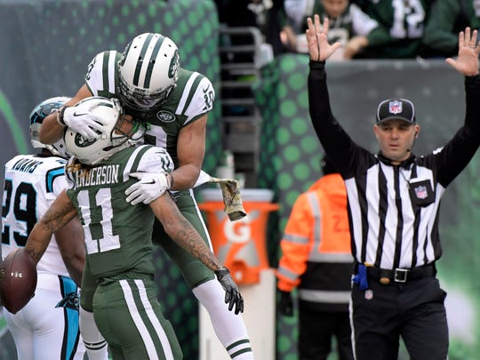 New York Jets wide receivers Robby Anderson (11) and Jermaine Kearse (10) celebrate Anderson's touchdown catch against the Carolina Panthers during the first half of an NFL football game, Sunday, Nov. 26, 2017, in East Rutherford, N.J. (AP Photo/Bill Kostroun)