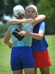 ShaeBug Scarberry, right, and Summer Marshall hug