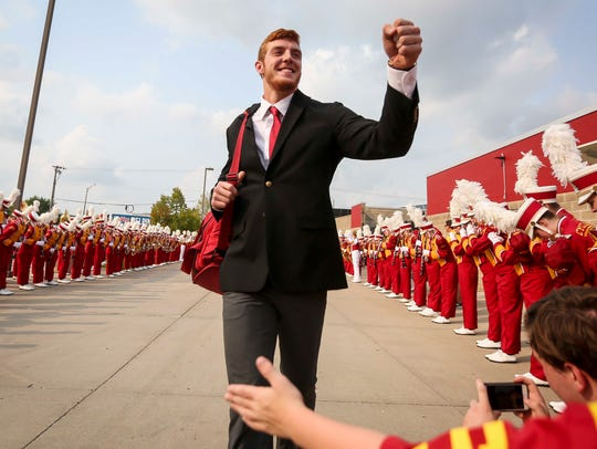ISU player Chase Allen fist bumps on arrival before
