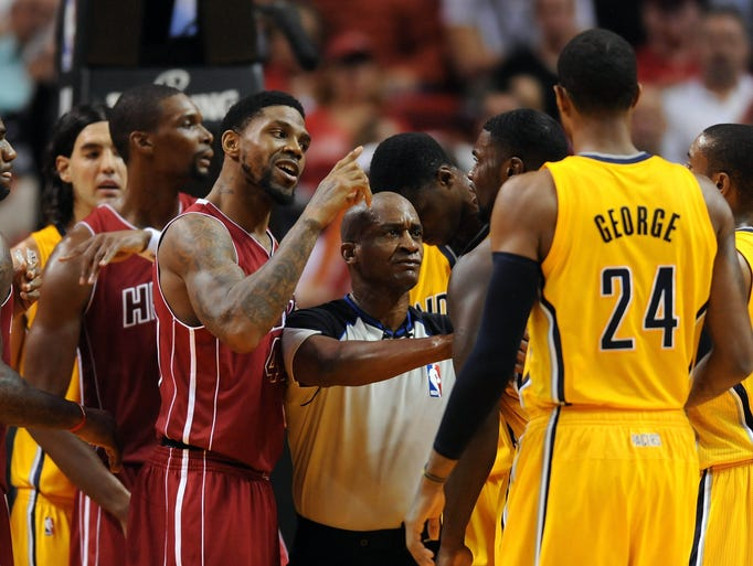 Dec 18, 2013; Miami, FL, USA; Miami Heat power forward Udonis Haslem (40) points at Indiana Pacers shooting guard Lance Stephenson (not pictured) during the first half at American Airlines Arena. Mandatory Credit: Steve Mitchell-USA TODAY Sports