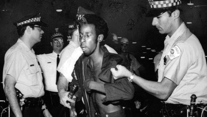 Chicago police made arrests after gunfire was exchanged by police and Black Panther Party members in 1969.