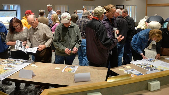 Sartell residents look over information on the proposed Sartell community center project Oct. 27 at Sartell City Hall.