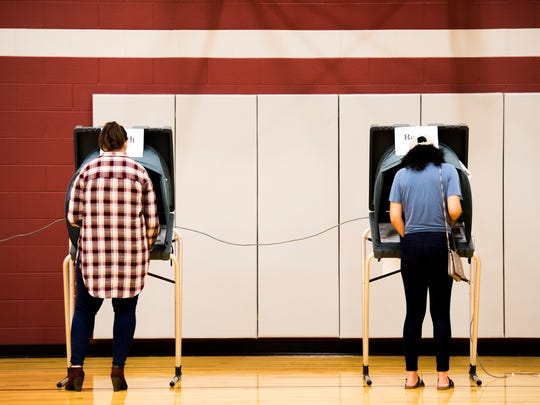 Voters cast their vote at Pond Gap Elementary School on Election Day in Knoxville on Tuesday, November 6, 2018.