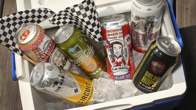 Drop the domestics. Here are some local craft beers (in a can) to take to the track.