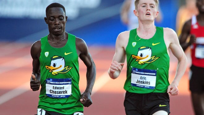 Oregon sophomore Edward Cheserek, left, beats out teammate Eric Jenkins to win the 10,000 meter run during the NCAA Men's Division I 2015 Outdoor Track & Field Championships at Hayward Field, on Wednesday, June 10, 2015, in Eugne, Ore.