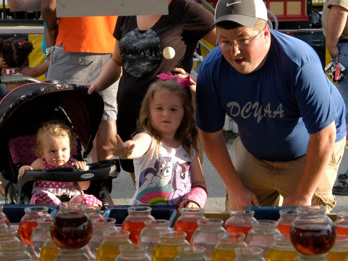 Pictured, from left, 4-year-old Bella and Charles Gibson play the fish bowl game May 30 evening at the annual Spring Festival at the Dickson County Fairgrounds.
