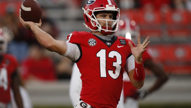 Georgia quarterback Stetson Bennett (13) warms up before the start of an NCAA college football game between Georgia and Auburn in Athens, Ga., on Saturday, Oct. 3, 2020.