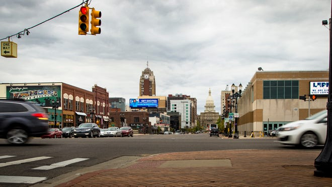 An electronic billboard on Michigan Avenue advertises the Lansing School District's summer programs Wednesday.