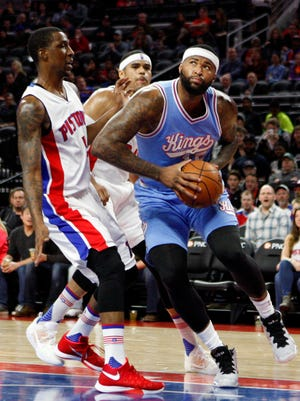 Kings center DeMarcus Cousins drives to the basket against Pistons guard Kentavious Caldwell-Pope uring the first quarter of the Pistons' 115-108 win Friday, March 18, 2016 at the Palace of Auburn Hills.
