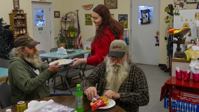 """Known affectionately as The Beards, Danny McElroy, left, and Terry Hill are served their regular breakfast by Mackenzie Arms, 17, Wednesday morning. """"We roll in here about everyday,"""" McElroy, a biscuits and gravy fan, said. Hill was doing a double sausage, egg and cheese sandwich with a side of Fritos corn chips and Diet Mountain Dew."""