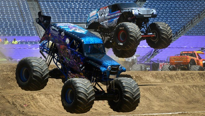 Ryan Anderson, left, drives Son-uva Digger along with veteran Monster Jam driver Linsey Weenk, driving the Lucas Oil Crusader, as they run through speed tests during practice for the upcoming Monster Jam show at Nissan Stadium on Friday June 17, 2016 in Nashville, Tenn. The Monster Jam is scheduled for Saturday night.