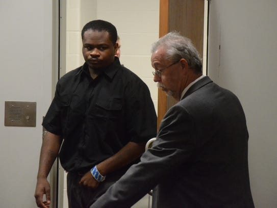Jermaine Jones enters the courtroom with his attorney