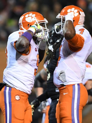 Clemson running back Wayne Gallman (9) celebrates with quarterback Deshaun Watson (4) after scoring against Wake Forest during the 4th quarter at Wake Forest's BB&T field on Saturday, November 19, 2016.