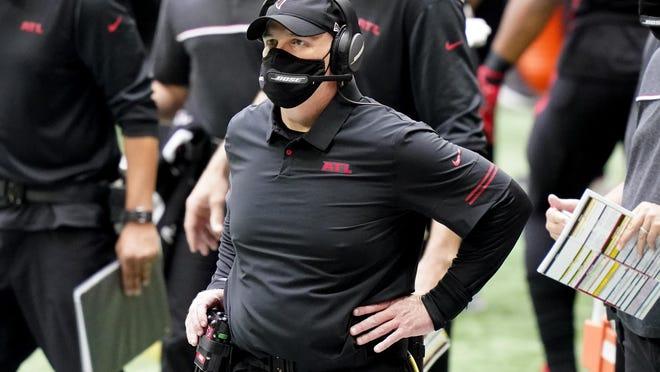 Atlanta Falcons head coach Dan Quinn watches play against the Chicago Bears during the second half Sunday in Atlanta. The Bears won 30-26.