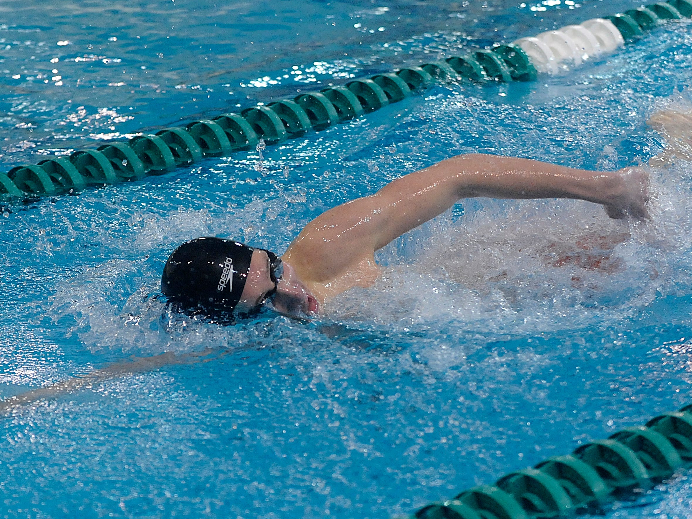 Granville's Timmy Spichiger swims in the 500 free during the division II district swimming Friday at Ohio University. Spichiger won the event and will advance to the state tournament. For more on district swimming, turn to 2B. For more photos, go to NewarkAdvocate.com