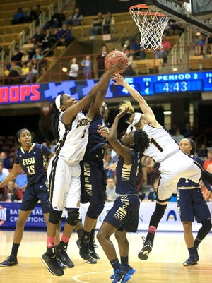 Chattanooga's Jasmine Joyner grabs the ball in a scramble with the ETSU defense during the SoCon women's championship game on Sunday afternoon at the U.S. Cellular Center. Chattanooga took home the championship title in overtime with a final score of 61-54.