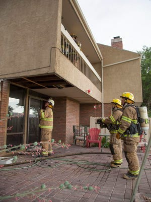 Fire fighters from the St. George Fire Department respond to a structure fire on the Bloomington Country Club Golf Course Wednesday, July 1, 2015.