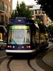 A streetcar navigates its way through Portland, Ore.,