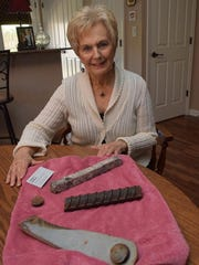 Martha Kay Gleason shows the pieces of steel from the O.K. Allen Bridge that she was given as mementoes. Her father, James E. Bamber Sr., helped build the bridge as a young man, and Gleason said she thought of him every time she rode over the bridge, which opened in 1936 and is scheduled to be demolished on Saturday.