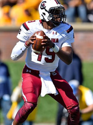 Oct 3, 2015; Columbia, MO, USA; South Carolina Gamecocks quarterback Lorenzo Nunez (19) drops back to attempt a pass against the Missouri Tigers during the first half at Faurot Field. Mandatory Credit: Jasen Vinlove-USA TODAY Sports