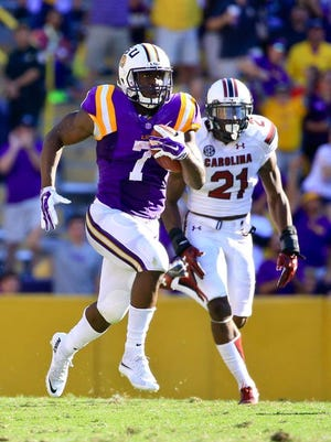 Oct 10, 2015; Baton Rouge, LA, USA; LSU Tigers running back Leonard Fournette (7) runs for a 87 yard touchdown against the South Carolina Gamecocks during the third quarter of a game at Tiger Stadium. LSU defeated South Carolina 45-24. Mandatory Credit: Derick E. Hingle-USA TODAY Sports