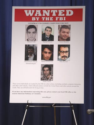 The FBI wanted poster of the seven Iranian hackers during a press conference at the Department of Justice in Washington, DC, USA, 24 March 2016. A grand jury in the Southern district of New York indicted seven Iranian on computer hacking charges.
