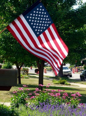 An American flag flies in the front yard of homeowners Erin and Mike Napier.