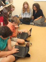 From left, William Jankens, Ryan Campbell, Emma Fariello, Lily Owens, Madison Wilkins work on a lesson from teacher Janine Malavasi.