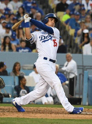 Cody Bellinger swings during Monday's game.
