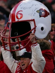Vito Trause holds up an oversized Westwood football helmet during the Cardinals' sectional championship victory in 2006.
