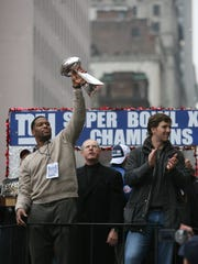 New York Giants Parade down Broadway celebrating their Super Bowl victory. Michael Strahan, coach Tom Coughlin and MVP Eli Manning on a float heading up Broadway with the Lombardi Trophy.