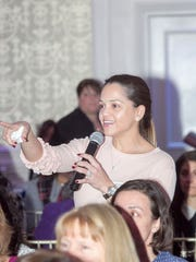 An audience member asking a question at the Women for Women event Tuesday in Paramus.