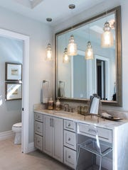 The master bathroom of the Aviano, a three-bedroom, fully furnished luxury model home built by Harbourside Custom Homes, in the exclusive gated village of Marsh Cove within the Fiddler's Creek community.