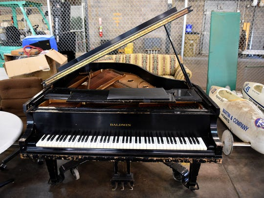 A baby grand piano was among the things Tim Woods, manager of Knoxville's Gov-Deals, showed off during a tour of their operation Nov. 17, 2016.