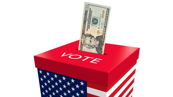 A twenty dollar bill being inserted into an election ballot box with the flag of the United States, conceptualizing the corrupt influence of big money on politics.